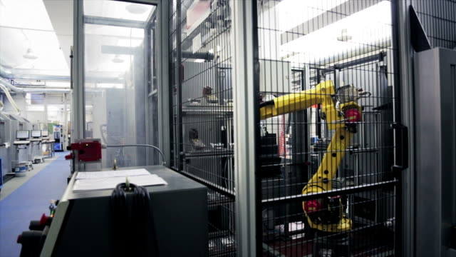 Robotic arms in assembly factory video