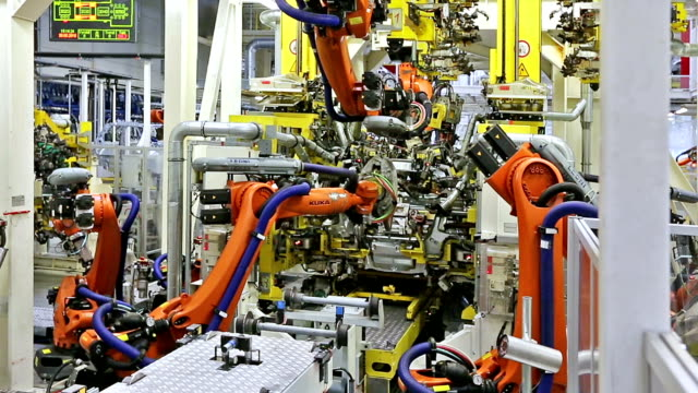robots in a car factory video