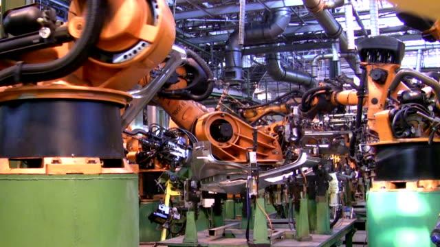 Robots weld car parts video