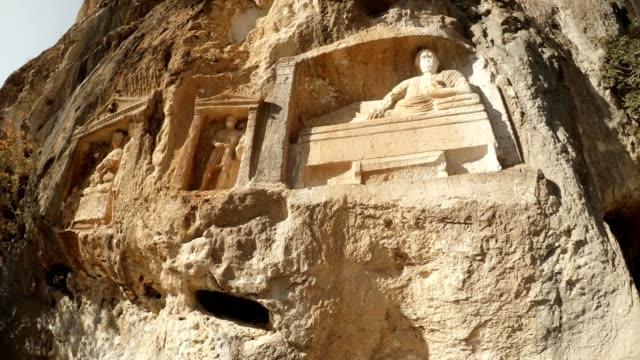 Rock carved figures in niches Adamkayalar Turkey famous landmark Mersin province video