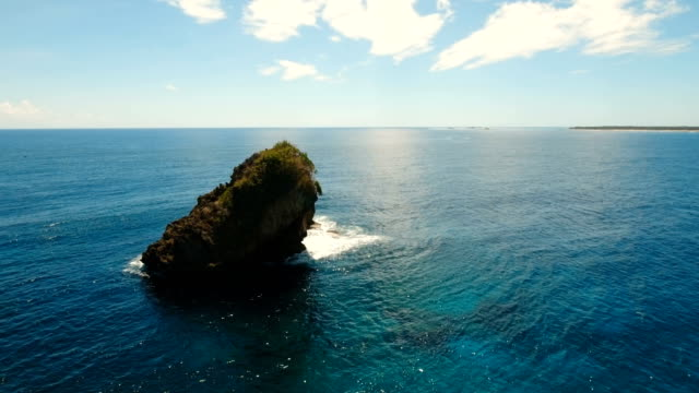 Rock, cliff in the blue sea. Philippines,Siargao.Aerial view video