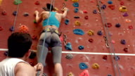 Rock climber ascending the wall video