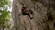 rock climber climbs difficult route and falls video