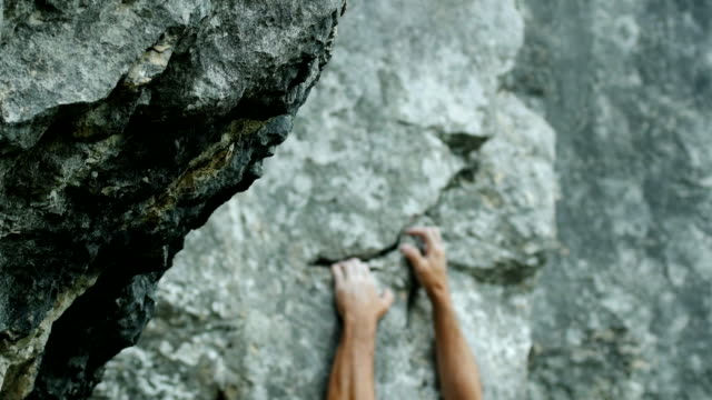 Rock Climber Searching For Hold (4K/UHD to HD) video