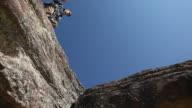 Rock climbers step over gap video