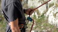 rock climbing belay device being used video