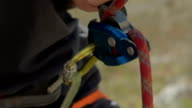 rock climbing rope passes through belay device video