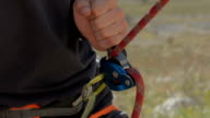 rock climbing using belay device to help  lower partner safely video