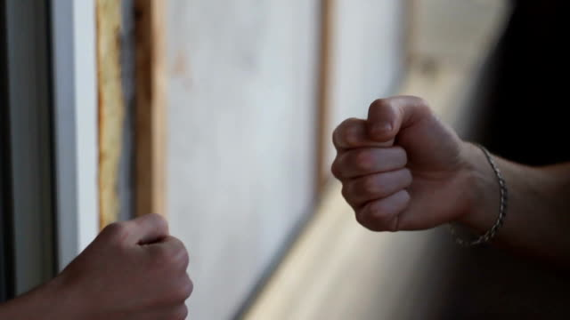 Rock paper scissors being played by two men high definition video video
