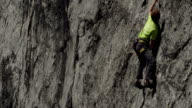 Rockclimber climbing limestone cliff video