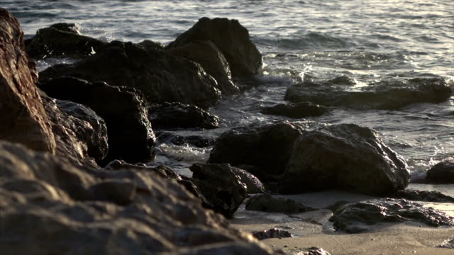 Rocks and Waves Painted Pink in Sunset video