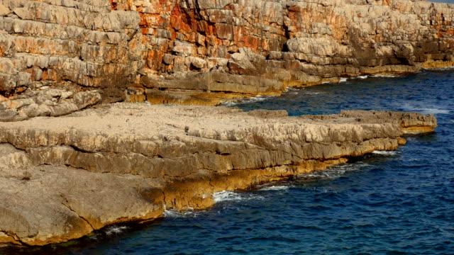 Rocks on the sea in Montenegro. Rocky coast. Wild beach. Dangero video