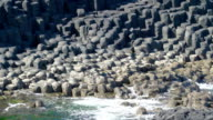 Rocks on the seashore in the Giants Causeway video
