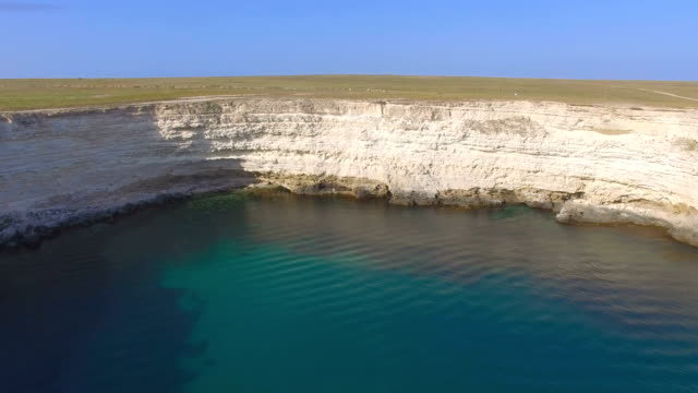 Rocky cliffs of sea coast, aerial video video