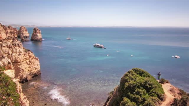 Rocky seashore and sailing ships. Cruise ships swimming in sea. Boat in sea video