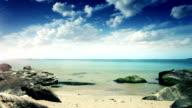 Rocky seaside against blue moody clouds video