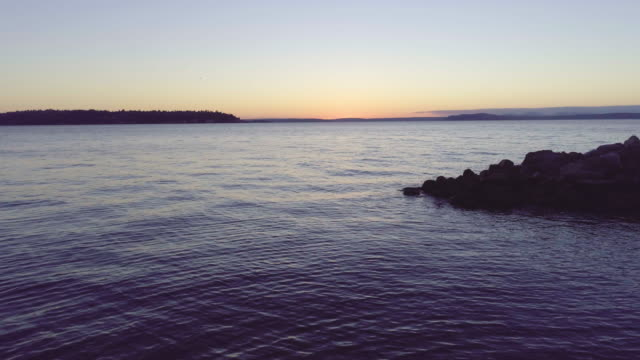 Rocky Shore Line at Sunset video