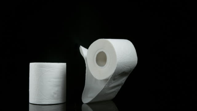 Roll of Toilet Paper Falling on Black Background, Slow Motion 4K video