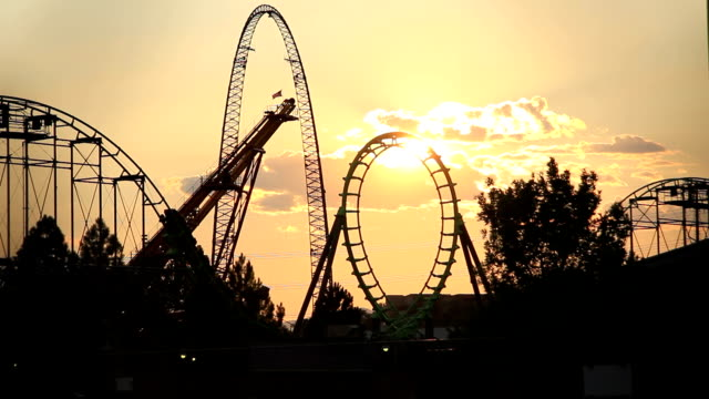 roller coaster loop through sunset video