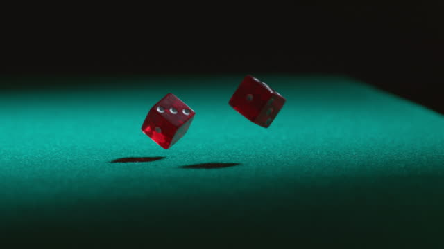 Rolling dice in slow motion video