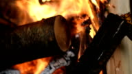 Rolling focus of a wood burning fire video