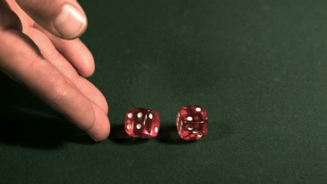 Rolling the dice, slow motion video