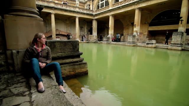 Roman Baths - Bath, England - Tourist Sits at Bath video
