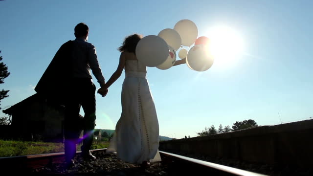 romantic atmosphere, a couple walks on railway video