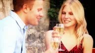 Romantic attractive couple drinking champagne video