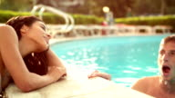 Romantic couple at edge of the pool video