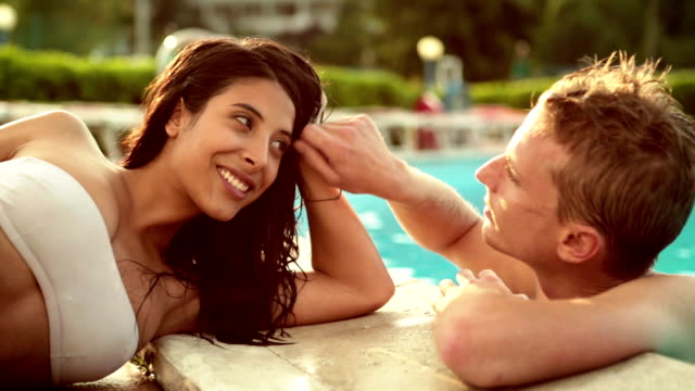 Romantic couple at the edge of pool video