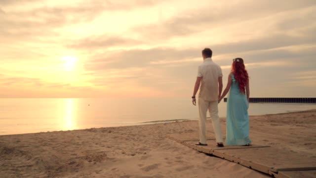 Romantic couple beach. Couple beach. Couple walking on beach. Love concept video