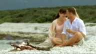 SLO MO Romantic couple on the beach in gentle wind video