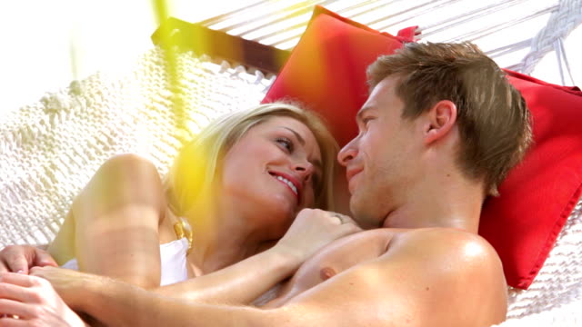 Romantic Couple Relaxing In Beach Hammock video