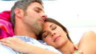 Romantic Couple Relaxing In Garden Hammock Together video