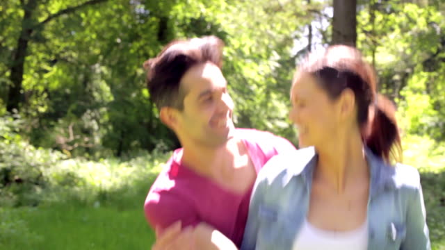 Romantic Couple Running Along Summer Woodland Path Together video