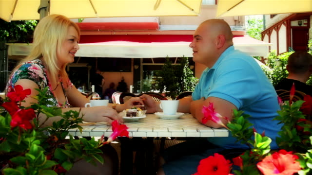 Romantic Couple sitting in summer cafe video