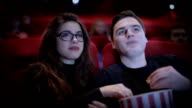 Romantic Couple waching a movie at cinema video