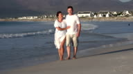 Romantic couple walking along beach, Cape Town, South Africa video
