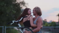 Romantic date of young couple on bicycles video