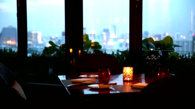 HD: Romantic Dining Table with cityscape background video