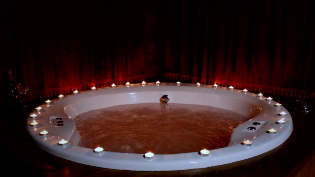 Romantic jacuzzi with candles video