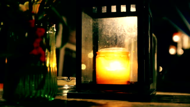 romantic lantern light, lamp with a candle on the table video