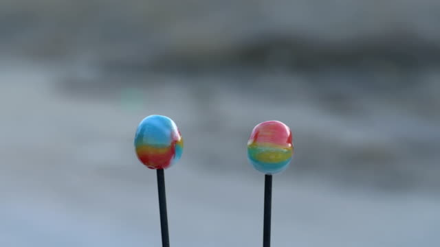 Romantic love story told by lollipops, couple of candy playing dramatic and humor story. Love and romance concept. video