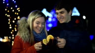 Romantic young couple drinking hot wine. video