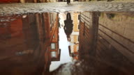Rome buildings reflected in puddle water video