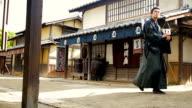 Ronin Samurai Warrior Dressed in Traditional Costume in an Edo Era Japanese Village video