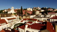 Roofs and narrow streets of Alfama in old Lisbon at morning aerial view video