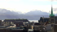 Roofs of old town in Lausanne on bank of Lake Geneva, majestic Alps on horizon video
