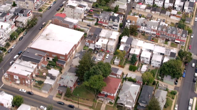 AERIAL: Rooftops of colorful row and twin houses in densely populated suburbs video